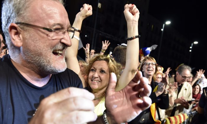 Catalan pro-independence supporters gather to celebrate the elections results, following the closing of polling stations during Catalan regional election on September 27, 2015 in Barcelona. (GERARD JULIEN/AFP/Getty Images)