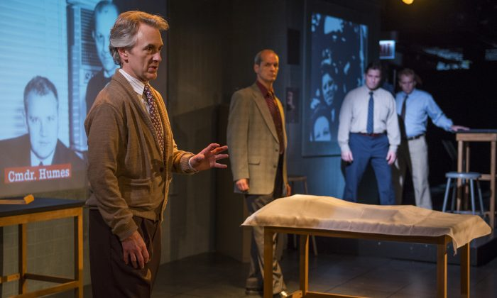 "(L–R) Michael Joseph Mitchell plays investigative reporter Hillel Levin explaining his theory of the assassination of President Kennedy. Mark Ulrich plays Zechariah Shelton, a retired FBI agent , who helps lead the audience through the information. Martin Yurek and Ryan Kitley play all the other characters in ""Assassination Theater."" (Michael Brosilow)"
