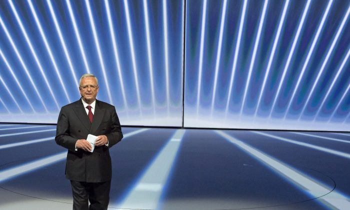 Martin Winterkorn, center, leaves the stage during the Volkswagen group night on the eve of the Frankfurt Auto Show IAA in Frankfurt, Germany, Sept. 14, 2015. (AP Photo/Jens Meyer)