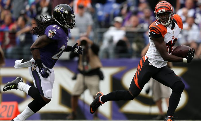 A.J. Green (R) caught 10 balls for 227 yards and two scores in a 28–24 win over the Ravens. (Patrick Smith/Getty Images)
