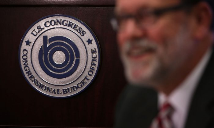 Congressional Budget Office Director Keith Hall speaks to the press during a media briefing at the Congressional Budget Office in Washington, D.C., on Aug. 25, 2015. (Alex Wong/Getty Images)