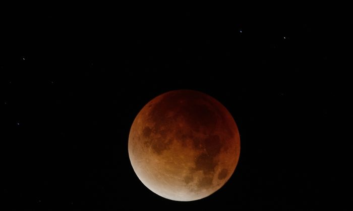 The blood-red light of a total eclipse seen in Nantes, western France, on September 28, 2015. (JEAN-SEBASTIEN EVRARD/AFP/Getty Images)