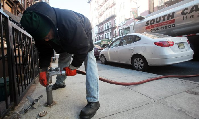 Stephen St. Clair of South Carolina Heating Fuel delivers heating oil to a building in Harlem, N.Y., on Jan. 12, 2010. (Mario Tama/Getty Images)