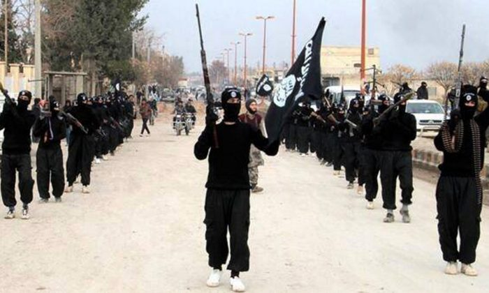 ISIS extremists parade down a street in Raqqa, Syria, on Jan. 14, 2014. (ISIS Website via AP)