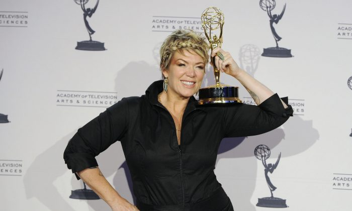"""FILE - In this Aug. 21, 2010 file photo, Mia Michaels poses with the award for outstanding choreography for """"So You Think You Can Dance"""" in the press room at the Creative Arts Emmy Awards in Los Angeles.  (AP Photo/Chris Pizzello, File)"""