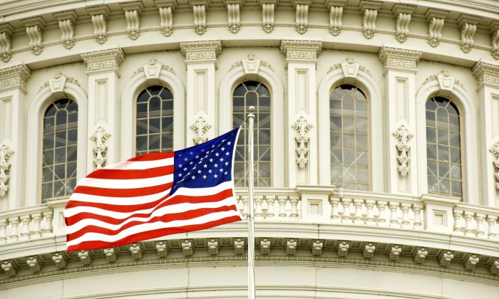 The U.S. flag in front of the Capitol building in Washington, D.C. (GBlakeley/iStock)