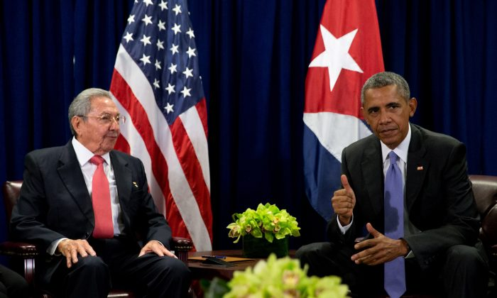 President Barack Obama and Cuban President Raul Castro sit together for members of the media before a bilateral meeting, Tuesday, Sept. 29, 2015, at the United Nations headquarters. (AP Photo/Andrew Harnik)