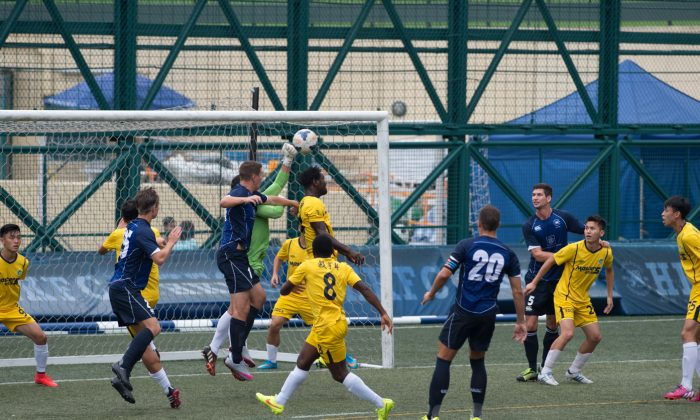Sun Source goalie punches clear to deny HKFC early in their HKFA Division 1 match at Sports Road on Sunday Sept 27, 2015. (Bill Cox/Epoch Times)