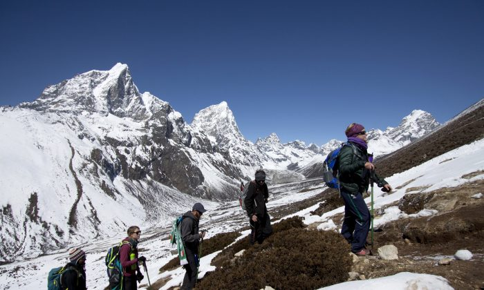 Trekkers on the way to Everest base camp, Nepal, on Mar. 18, 2015. (AP Photo/Tashi Sherpa, file)