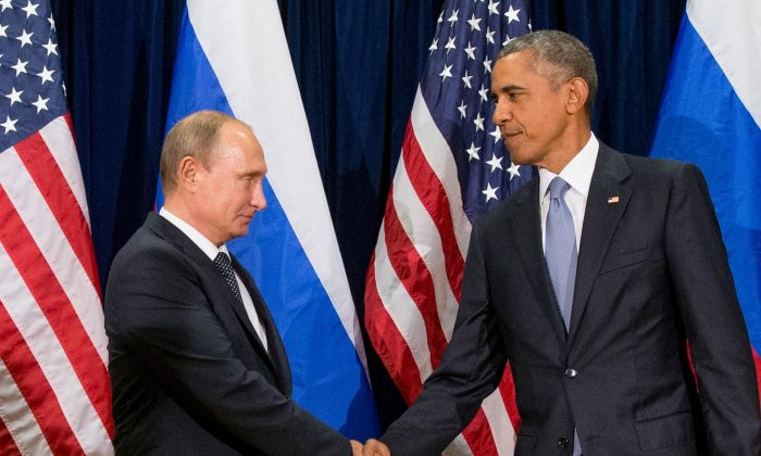 United States President Barack Obama (R) and Russia's President President Vladimir Putin pose for members of the media before a bilateral meeting at United Nations headquarters on Sept. 28, 2015. (AP Photo/Andrew Harnik)