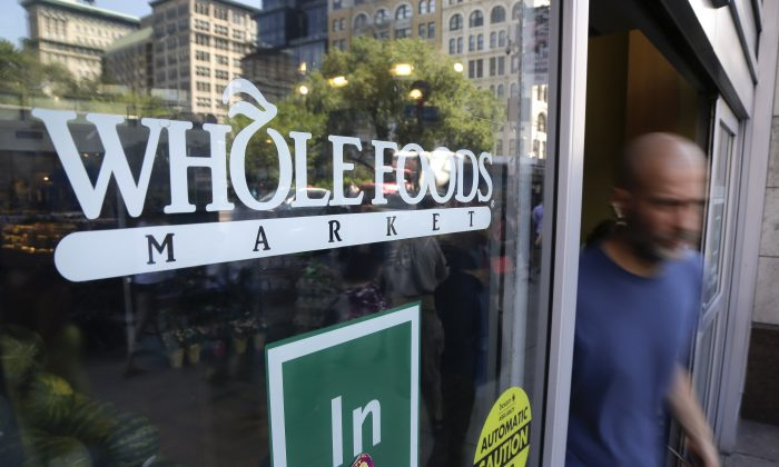 A shopper leaves a Whole Foods Market store in Union Square, in New York, on June 24, 2015. (Julie Jacobson/File via AP)