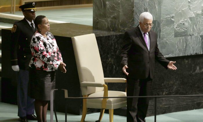 Mahmoud Abbas, President of the State of Palestine, gestures after addressing the 70th session of the United Nations General Assembly on Wednesday, Sept. 30, 2015 at U.N. Headquarters.  (AP Photo/Mary Altaffer)