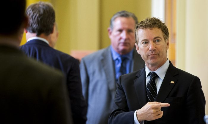 Republican presidential candidate, Sen. Rand Paul, R-Ky. points while talking with visitors on Capitol Hill in Washington, Wednesday, Sept. 30, 2015. (AP Photo/Jacquelyn Martin)