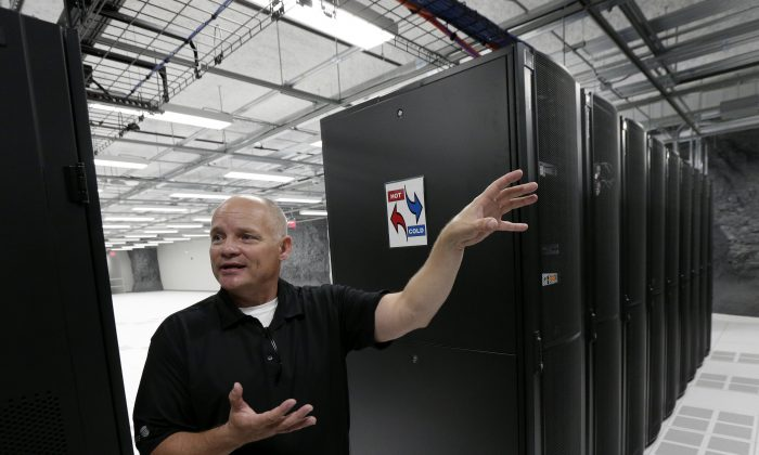 Bob Perkins, facilities manager at LightEdge Data Center, talks about the company's new data storage facility in Kansas City, Mo., Tue., July 14, 2015. (AP Photo/Charlie Riedel)