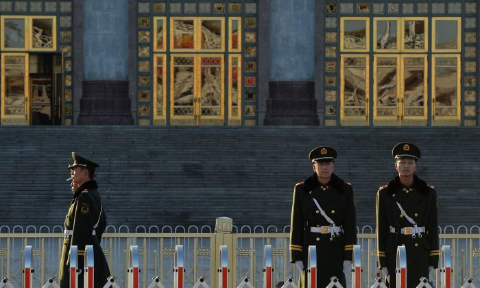 Chinese paramilitary police patrol the Great Hall of the People in November 2013. (Mark RalstonAFP/Getty Images)