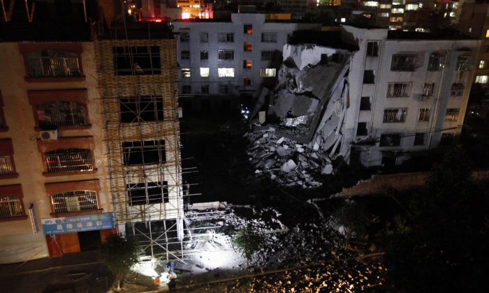 Investigators check the site of a series of blasts at a damaged building in Liucheng county in Liuzhou in south China's Guangxi province on Sept. 30, 2015. (STR/AFP/Getty Images)