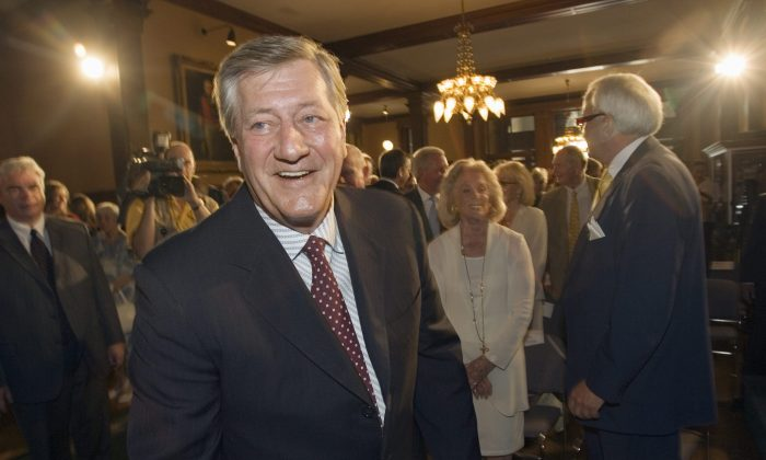 Former Ontario Premier Mike Harris at the unveiling ceremony for his official portrait at the Ontario Legislature in Toronto on June 26, 2007. A new report ranks Harris as the best premier since 1981 in the area of fiscal and economic outcomes. (CP PHOTO/Frank Gunn)
