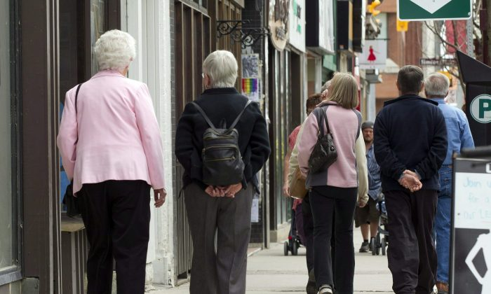 Senior citizens make their way down a street in Peterborough, Ont., May 7, 2012. Statistics Canada says the country's population now features more seniors than children, indicating a long-projected shift in Canada's demographic makeup. (The Canadian Press/Frank Gunn)