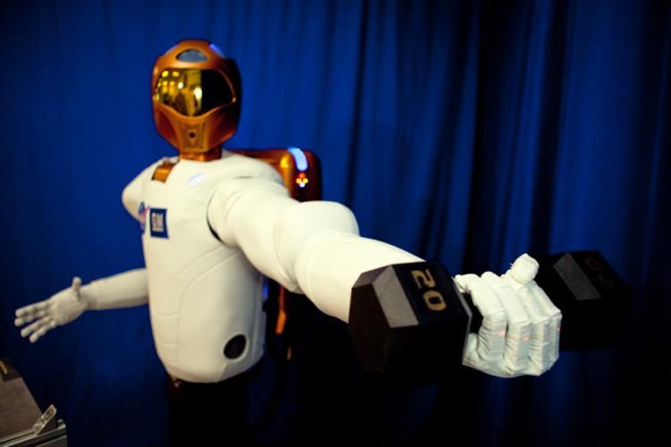 R2: According to NASA's website, R2 surpasses previous dexterous humanoid robots in strength, yet is safe enough to work side-by-side with humans. It is able to lift, not just hold, this 20-pound weight (about four times heavier than what other dexterous robots can handle) both near and away from its body. (Courtesy of NASA.gov)