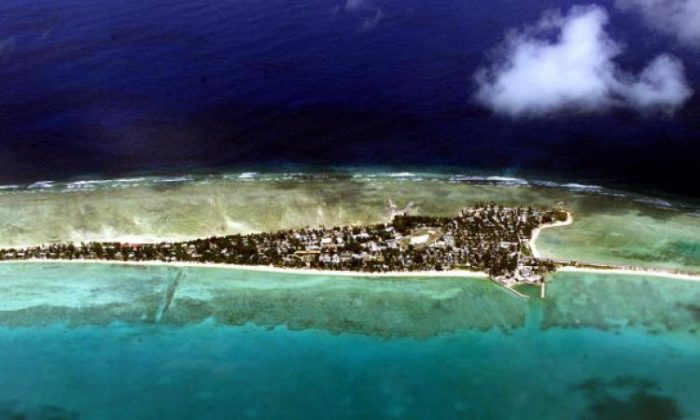 There is not much room to retreat from rising sea levels on Tarawa atoll, capital of the vast archipelago nation of Kiribati. (Torsten Blackwood/AFP/Getty Images)
