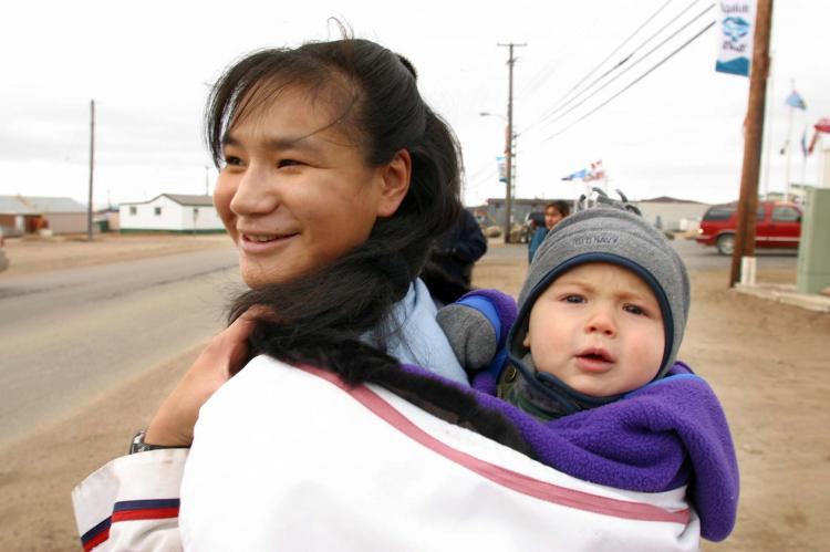 A file photo of a woman and her baby in Iqaluit, the capital of Nunavut. Nunavut enters 2011 with a TB infection rate 62 times the national average, the highest since the territory's creation 11 years ago. (Andre Forget/AFP/Getty Images)