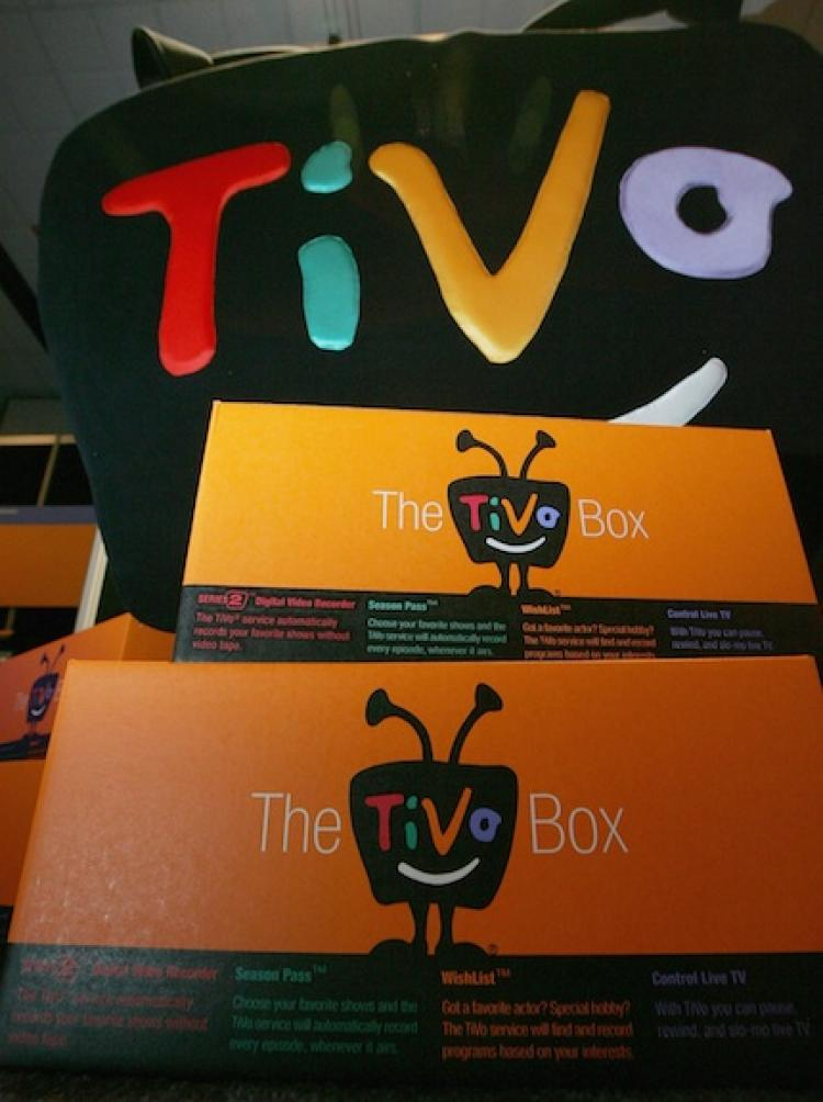 AD KILLER?: A TiVo display with stacked boxes of the digital video recorders. A recent study found that, despite popular belief, the devices do not effect the buying behaviors of consumers.  (Justin Sullivan/Getty Images)