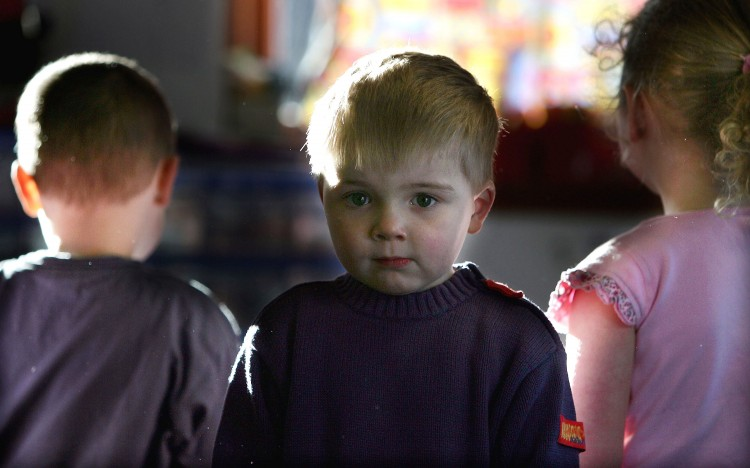 Picture of a three-year-old boy attending a private nursery school January 28, 2005 in Glasgow, Scotland. (Christopher Furlong/Getty Images)