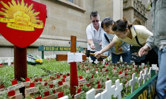 The field of remembrance run by the War Widow's Guild NSW, for ANZAC Day, 25 April. Small wooden crosses each with a sprig of rosemary in memory of those lost.  (Rob Elliott/AFP/Getty Images)