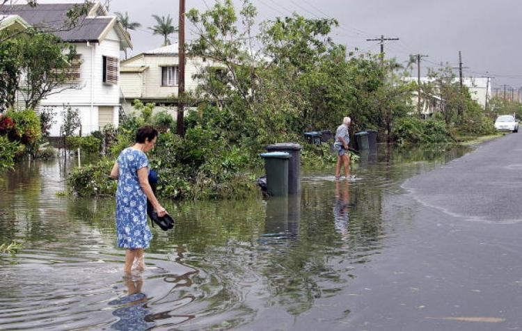 North Queensland experienced extreme rainfall and floods earlier this year while the south east of Australia was experiencing heatwaves and off the scale bushfires.  (Torsten Blackwood/AFP/Getty Images)