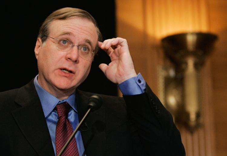In this file photo, Microsoft co-founder Paul G. Allen speaks during a news conference on Capitol Hill in September 2006 in Washington. Allen's patent holding company, Interval Research, is suing 11 major corporations on grounds of patent infringement.