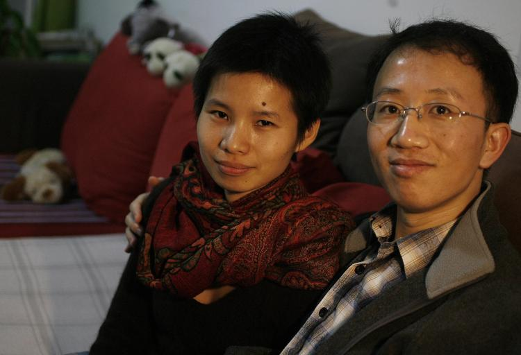 Human rights activists Hu Jia (R) and his wife Zeng Jinyan (L) during their house arrest, monitored by police and internal security police, in their housing complex ironically named Bobo Freedom City.   (Frederic J. Brown/AFP/Getty Images)