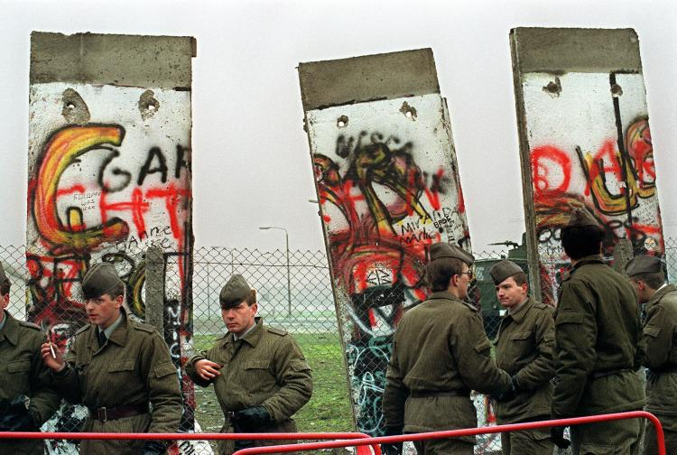 East German border guards demolishing a section of the Berlin wall in order to open a new crossing point between East and West Berlin at the border line near the Potsdamer Square on Nov. 11 1989. (Gerard Malie/AFP/Getty Images)