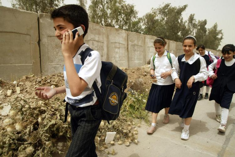 Children using cell phones are at risk. (Ali Yussef/AFP/Getty Images )