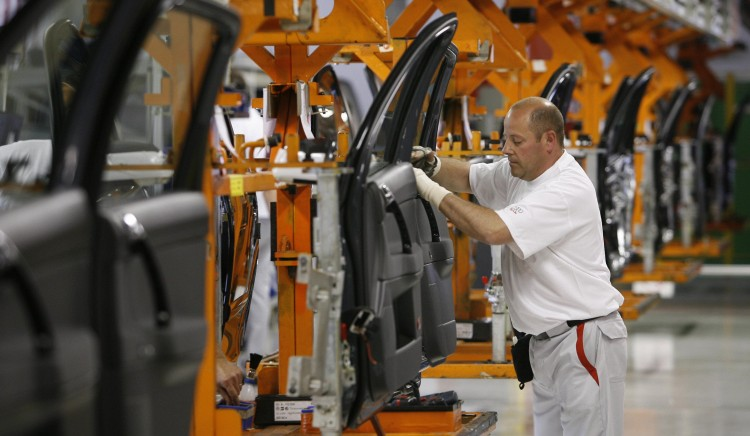 In this file photo, a plant worker is seen assembling Audi car doors at the company's plant in Brussels, Belgium. Audi is in the process of setting up a production plant in Mexico to meet higher demand. (Benoit Doppagne/AFP/Getty Images)