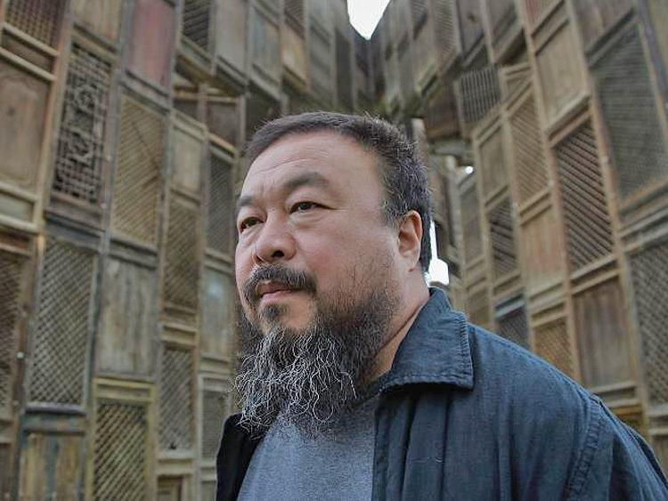 Chinese Artist Ai Weiwei poses in front of his sculpture 'Template'. Ai was disappeared by the authorities on April 3 . An unconfirmed, anonymous article says that he confessed to charges of tax evasion after being tortured in custody. (Simon/Getty Images)