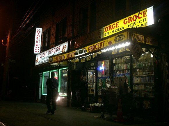 An evening scene outside of a bodega grocery store