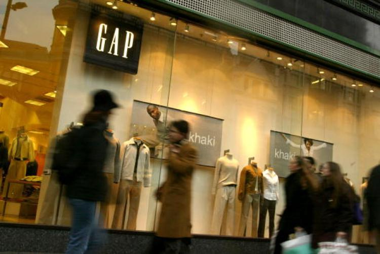 People walk past a Gap store on Oxford Street in London. The Gap Inc. is looking up lately as the company increasingly leverages social and environmental awareness programs to appeal to its young and progressive clientele. (Sion Touhig/Getty Images)