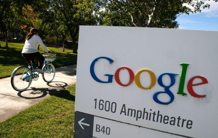 A Google employee rides a bicycle at the company's headquarters in Mountain View, California. Google Inc. announced in an e-mail to users that from Friday, April 29 onward, its Google Video service will be shut down.