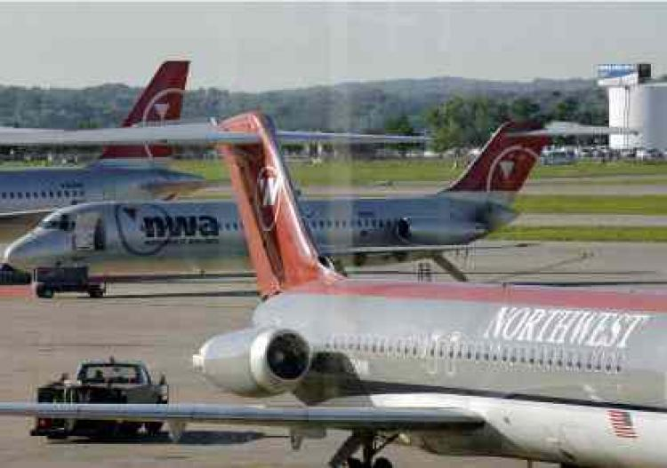 This shows a Northwest airliners jet at Minneapolis airport on August 20, 2005.  (Paul J. Richards/Getty Images)