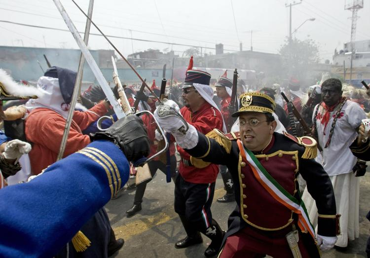Cinco De Mayo, the real story: A group of actors reenact the 1862 Battle of Puebla to commemorate their victory over the French Army, in Mexico City on May 5, 2008. (Alfredo Estrella/Getty Images)