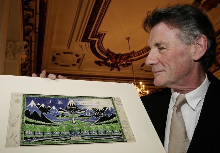 JRR Tolkien: Michael Palin holds an original artwork of JRR Tolkien's 'The Hobbit' at the launch of the 'Oxford Thinking' campaign in London on May 28, 2008. (Leon Neal/AFP/Getty Images)