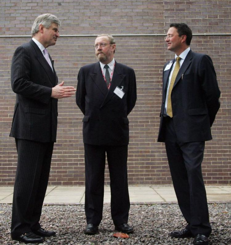 Britain's chief scientific adviser Professor John Beddington (center) says climate researchers must be more honest and open about the uncertainties surrounding climate change. (Matt Cardy/Getty Images)
