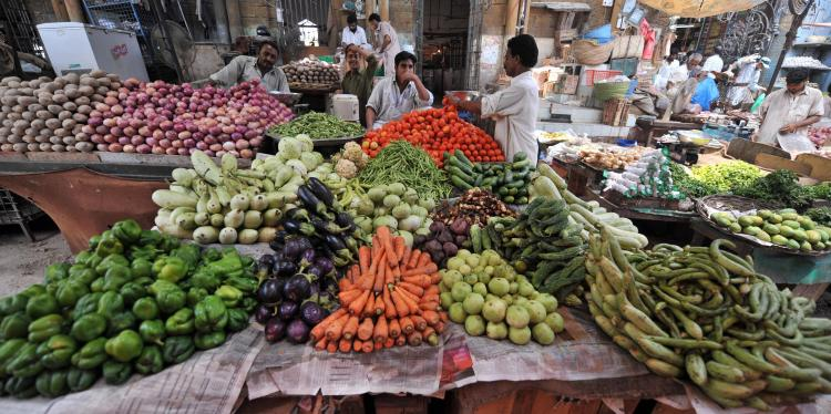 Pakistani vegetable vendors wait for customers at a market in Karachi. (RIZWAN TABASSUM/AFP/Getty Images)