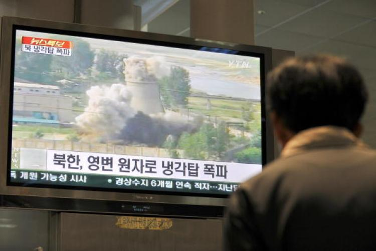 A TV screen showing footage of the public demolition of North Korea's cooling tower at its Yongbyon nuclear complex in Seoul on June 27, 2008. North Korea blew up the cooling tower to symbolise the communist state's commitment to scrapping its nuclear programme. (Jung Yeon-Je/AFP/Getty Images)