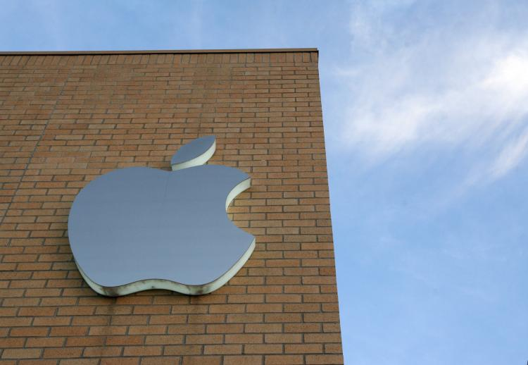 The Apple logo is illuminated on the side of the Apple Store at daybreak July 11, in Dallas, Texas. Apple release it's 2nd generation iPhone today called the iPhone 3G. (Rick Gershon/Getty Images)