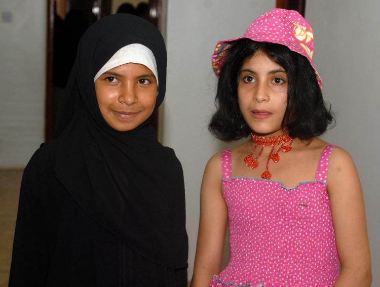 Yemeni child brides, Nujood Ali (L) and Arwa (R), pose for a picture as they celebrate their divorces, granted them by a Yemeni court in the capital Sana'a on July 30, 2008. (Khaled Fazaa/AFP/Getty Images)