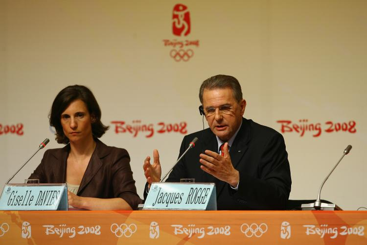 Jacques Rogge, the IOC president and Giselle Davies, the IOC Director of Communications, at a press conference.  (Julian Finney/Getty Images)