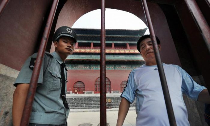 A security guard blocks access to the historic Drum Tower in Beijing.  (Mark Ralston/AFP/Getty Images)