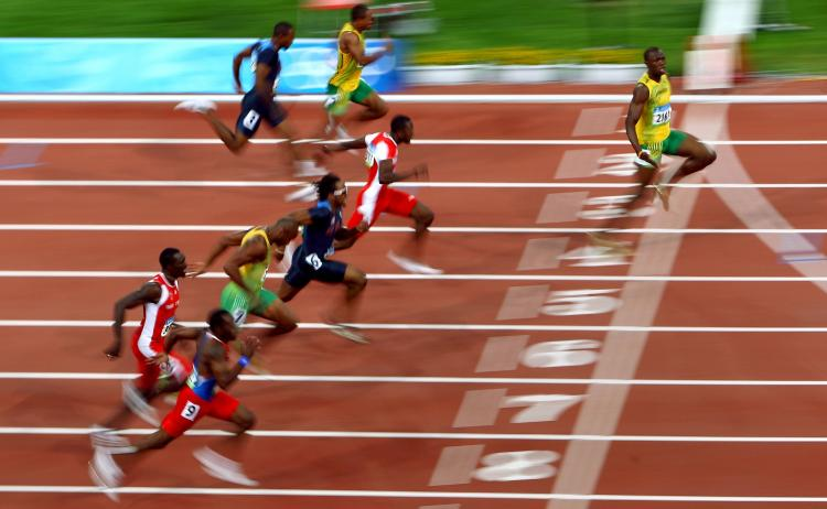 AUGUST 16: Usain Bolt of Jamaica (R) crosses the line on his way to winning the Men's 100m Final at the National Stadium on Day 8 of the Beijing 2008 Olympic Games (Rys/Bongarts/Getty Images)