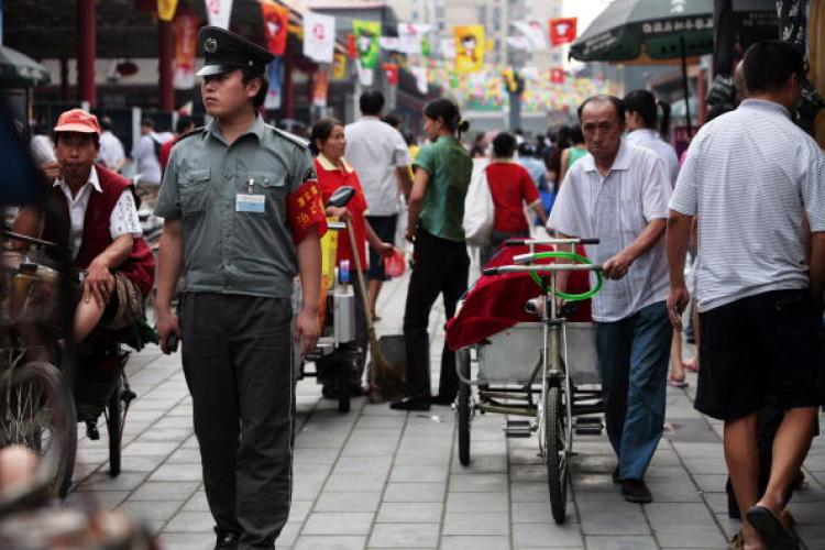 People have complained that there is a lack of festivity for the Games in Beijing. It seems most likely that those who are the happiest are the ones profiting from the games. ( Paula Bronstein/Getty Images)